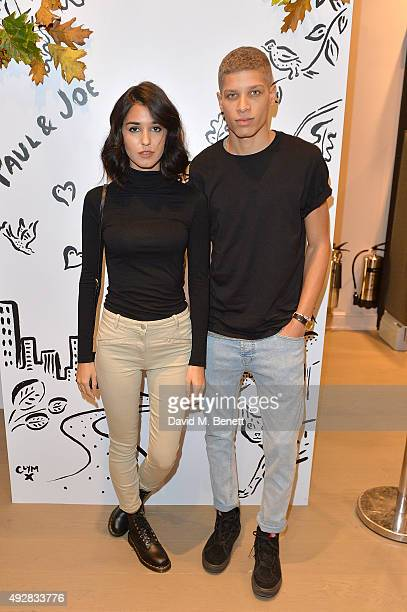 Ashley Sky and Chuck Achike attend the launch of the Paul Joe London flagship store hosted by Grey Goose on October 15 2015 in London England