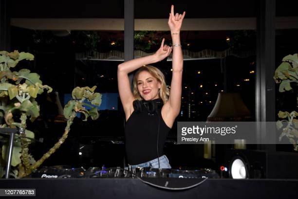 Ashley Smith DJs during Rolla's x Sofia Richie Launch Event at Harriet's Rooftop on February 20 2020 in West Hollywood California