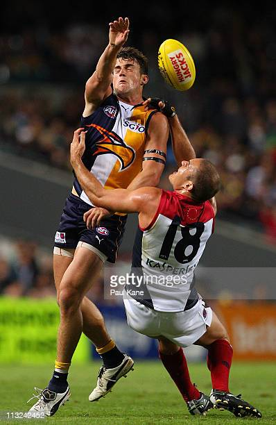 Ashley Smith of the Eagles and Brad Green of the Demons contest a mark during the round six AFL match between the West Coast Eagles and the Melbourne...