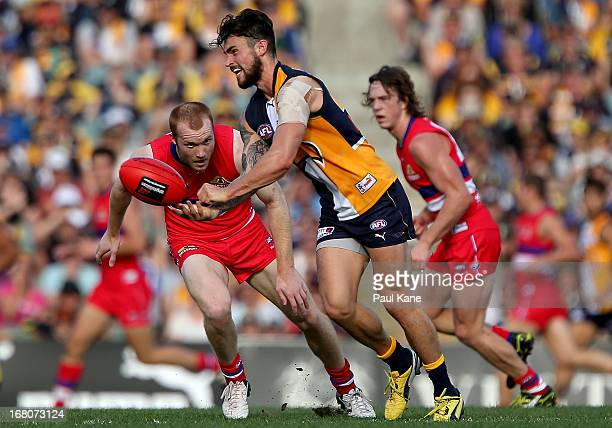 Ashley Smith of the Eagles handballs during the round six AFL match between the West Coast Eagles and the Western Bulldogs at Patersons Stadium on...