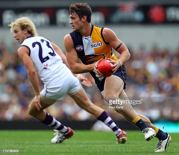 Ashley Smith of the Eagles looks to pass the ball during the round eight AFL match between the West Coast Eagles and the Fremantle Dockers at...
