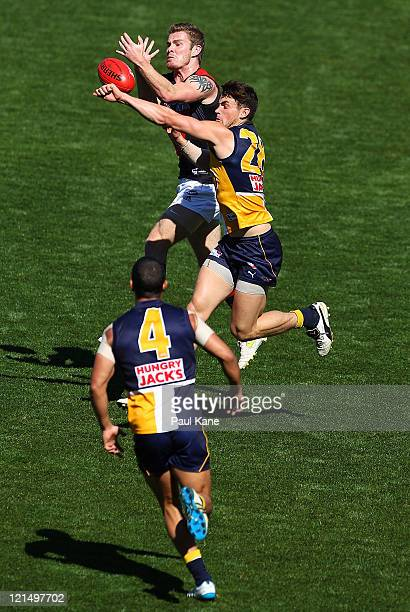 Ashley Smith of the Eagles spoils the mark for Kyle Reimers of the Bombers during the round 22 AFL match between the West Coast Eagles and the...