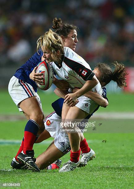 Ashley Steacy of Canada is tackled during the Women's Final match between Canada and France during day one of the 2014 Hong Kong Sevens at Hong Kong...