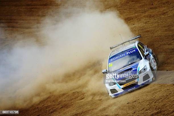 Ashley Sutton of Adrian Flux Subaru Racing slides off into the gravel at Paddock Hill Bend during the Dunlop MSA British Touring Car Championship at...