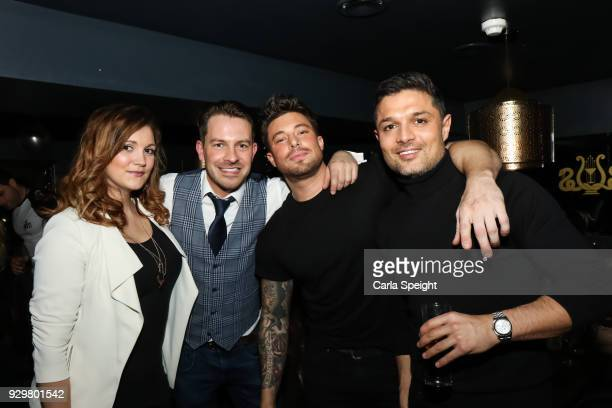 Ashley Taylor Dawson and Duncan James Pose with friends at the Hollyoaks Open Mic Night at The Symposium Bar on March 8 2018 in Wilmslow England