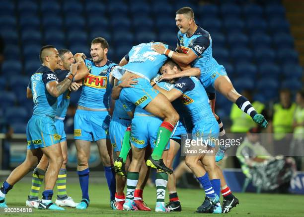 Ashley Taylor of the Titans celebrates the winning try with his team during the round one NRL match between the Gold Coast Titans and the Canberra...
