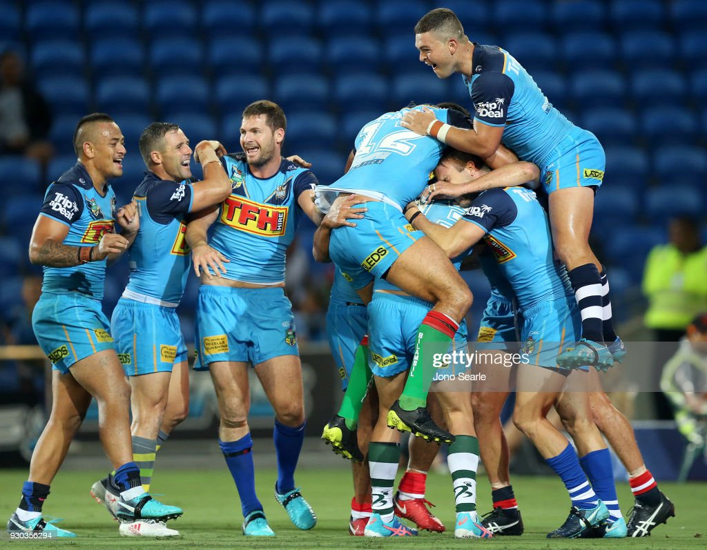 Ashley Taylor (right) of the Titans celebrates the winning try with his team during the round one NRL match between the Gold Coast Titans and the Canberra Raiders at Cbus Super Stadium on March 11, 2018 in Gold Coast, Australia.
