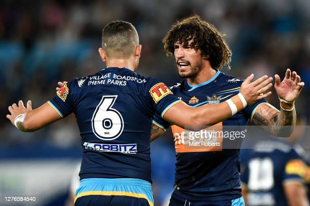 Ashley Taylor of the Titans celebrates with Kevin Proctor of the Titans during the round 20 NRL match between the Gold Coast Titans and the Newcastle...