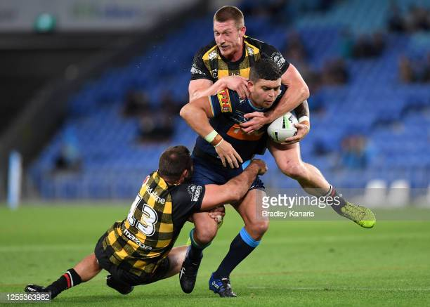Ashley Taylor of the Titans is tackled during the round nine NRL match between the Gold Coast Titans and the New Zealand Warriors at Cbus Super...