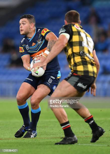 Ashley Taylor of the Titans looks to offload the ball during the round nine NRL match between the Gold Coast Titans and the New Zealand Warriors at...