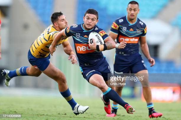 Ashley Taylor of the Titans makes a break during the round 2 NRL match between the Gold Coast Titans and the Parramatta Eels at Cbus Super Stadium on...