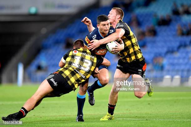 Ashley Taylor of the Titans takes on the defence during the round nine NRL match between the Gold Coast Titans and the New Zealand Warriors at Cbus...
