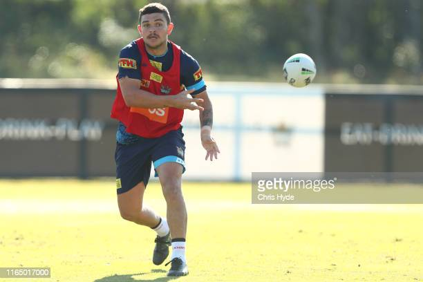 Ashley Taylor passes during a Gold Coast Titans NRL training session at Titans High Performance Centre on July 30, 2019 in Gold Coast, Australia.