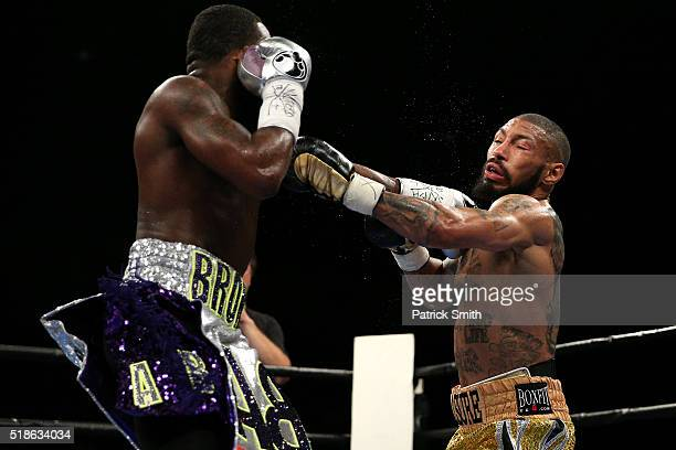 Ashley Theophane and Adrien Broner exchange punches in their super lightweight championship bout at the DC Armory on April 1, 2016 in Washington, DC.