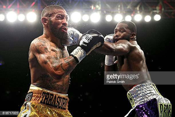Ashley Theophane and Adrien Broner exchange punches in their super lightweight championship bout at the DC Armory on April 1 2016 in Washington DC