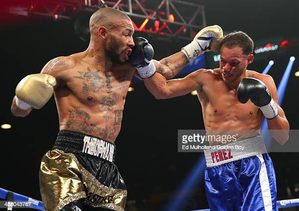 Ashley Theophane and Angino Perez trade punches during their welterweight fight at the MGM Grand Garden Arena on May 3, 2014 in Las Vegas, Nevada.
