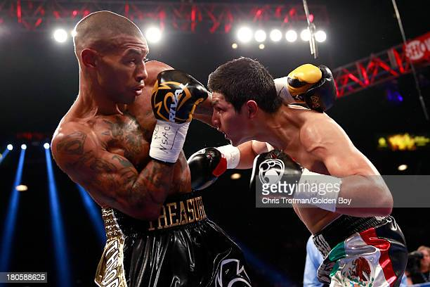 Ashley Theophane and Pablo Cesar Cano exchange blows during their welterweight fight at the MGM Grand Garden Arena on September 14, 2013 in Las...