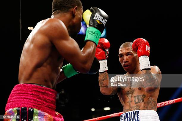 Ashley Theophane and Steven Upsher square off during their junior welterweight fight at MGM Grand Garden Arena on September 12, 2015 in Las Vegas,...