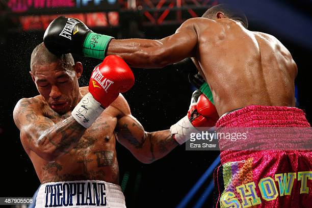 Ashley Theophane and Steven Upsher trade punches during their junior welterweight fight at MGM Grand Garden Arena on September 12, 2015 in Las Vegas,...