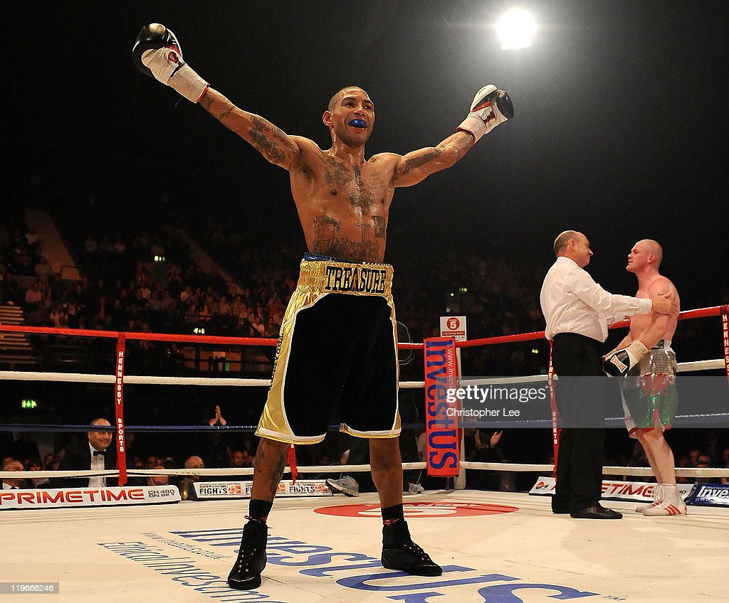 Ashley Theophane celebrates as he knocks out Jason Cook during the British Light welterweight Title fight at Wembley Arena on July 23, 2011 in London, England.