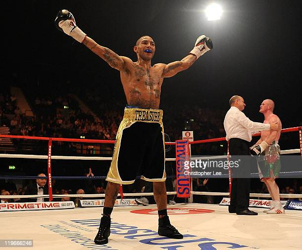 Ashley Theophane celebrates as he knocks out Jason Cook during the British Light welterweight Title fight at Wembley Arena on July 23, 2011 in...