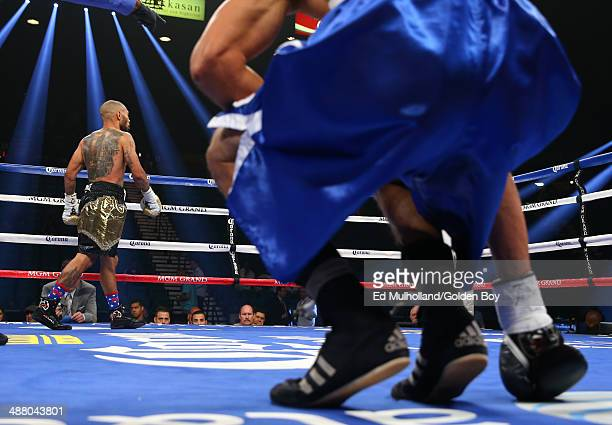 Ashley Theophane knocks down Angino Perez during their welterweight fight at the MGM Grand Garden Arena on May 3, 2014 in Las Vegas, Nevada.