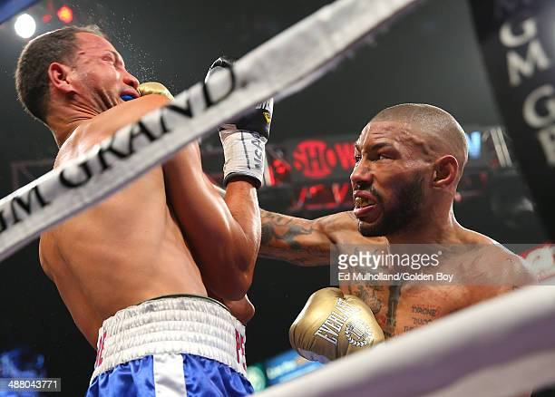 Ashley Theophane lands a right hand to the head of Angino Perez during their welterweight fight at the MGM Grand Garden Arena on May 3, 2014 in Las...