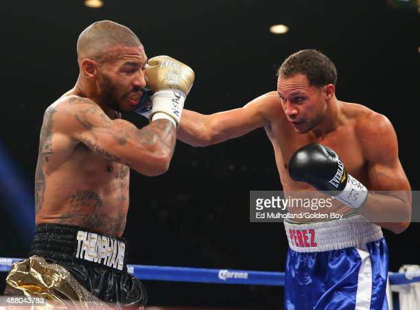 Ashley Theophane takes a right hand to the head from Angino Perez during their welterweight fight at the MGM Grand Garden Arena on May 3, 2014 in Las...