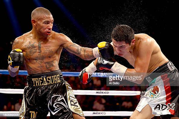 Ashley Theophane throws a left at Pablo Cesar Cano during their welterweight fight at the MGM Grand Garden Arena on September 14, 2013 in Las Vegas,...