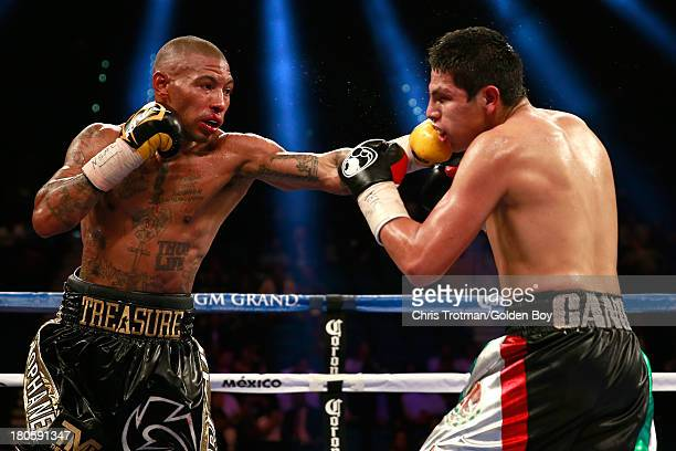 Ashley Theophane throws a left to the head of Pablo Cesar Cano during their welterweight fight at the MGM Grand Garden Arena on September 14, 2013 in...