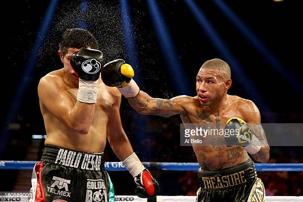 Ashley Theophane throws a right at Pablo Cesar Cano during their welterweight fight at the MGM Grand Garden Arena on September 14, 2013 in Las Vegas,...
