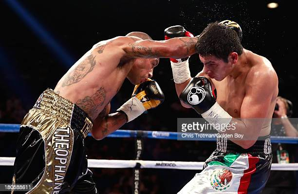 Ashley Theophane throws a right to the head of Pablo Cesar Cano during their welterweight fight at the MGM Grand Garden Arena on September 14, 2013...