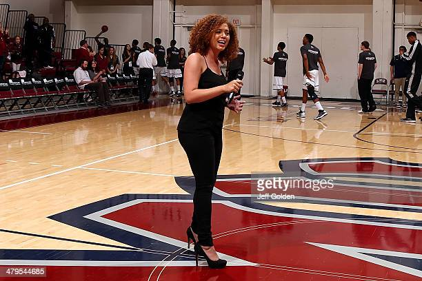 Ashley Thomas of the LMU Pep Band finishes singing the National Anthem at center court before the game between the Pepperdine Waves and the Loyola...