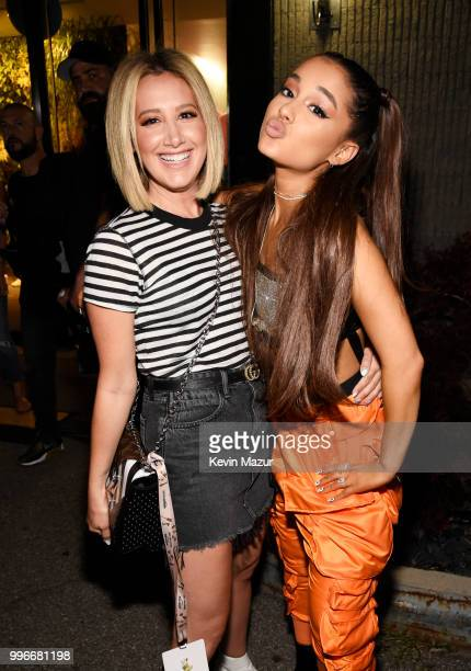 Ashley Tisdale and Ariana Grande pose backstage at the Amazon Music Unboxing Prime Day event in Brooklyn on July 11 2018 in Brooklyn New York