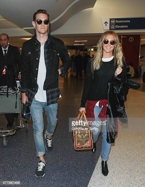 Ashley Tisdale and Christopher French are seen at LAX on June 16 2015 in Los Angeles California