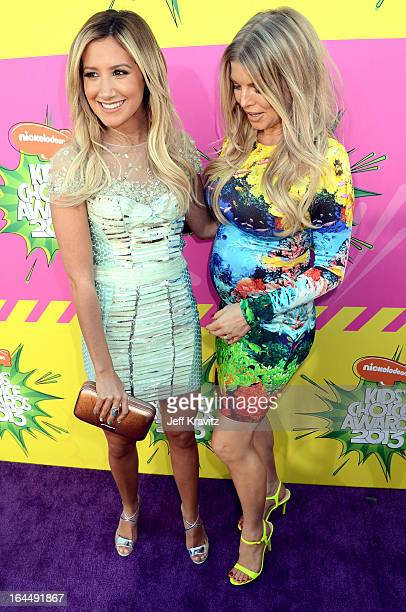 Ashley Tisdale and Fergie arrive at Nickelodeon's 26th Annual Kids' Choice Awards at USC Galen Center on March 23 2013 in Los Angeles California