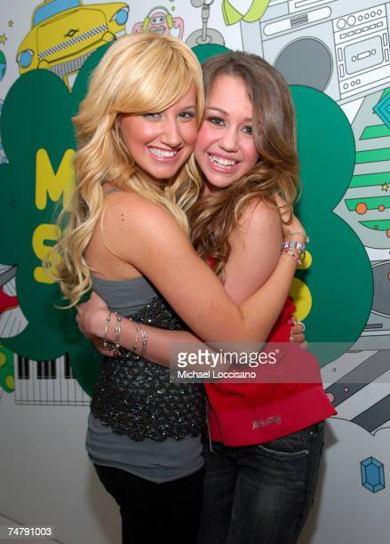 """Ashley Tisdale and Miley Cyrus at the Ashley Tisdale and Miley Cyprus Visit MTV's """"TRL"""" - June 20, 2006 at MTV Studios - Times Square in New York..."""