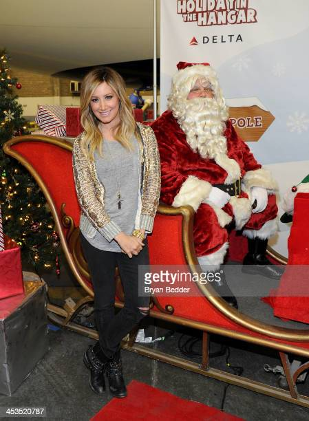 Ashley Tisdale and Santa Claus join Delta Air Lines and YMCA Of Greater New York at 'Holiday Flight to The North Pole' event for PS 197 elementary...