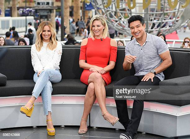 Ashley Tisdale Charissa Thompson and Mario Lopez visit 'Extra' at Universal Studios Hollywood on May 31 2016 in Universal City California