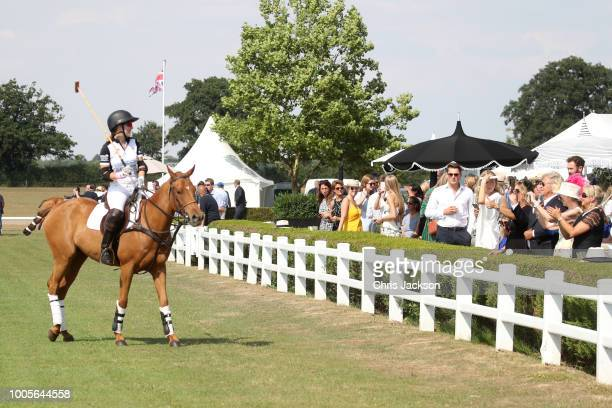 Ashley van Metre Busch of Sentebale St Regis looks at the crowd as she competes during the Sentebale Polo 2018 held at the Royal County of Berkshire...