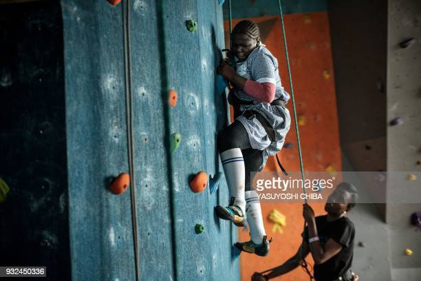 TOPSHOT Ashley Wafula challenges rope climbing on the artificial climbing wall during a weeklong free climbing training for visually impaired and...