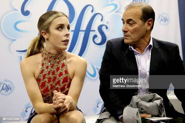 Ashley Wagner and her coach Rafael Arutunian react to her score in the kiss and cry after skating in the Ladies Short Program during the 2018...