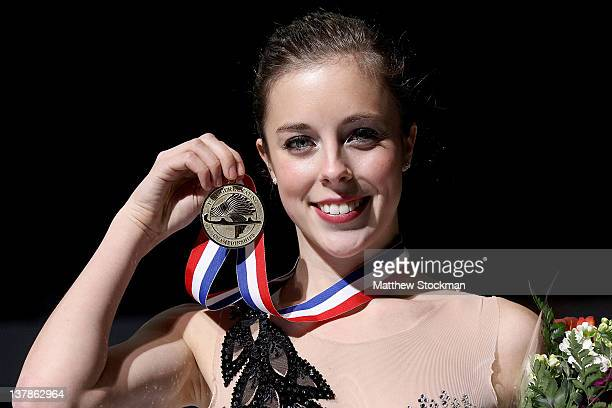 Ashley Wagner poses for photographers after winning the Ladies competition during the 2012 Prudential US Figure Skating Championships at the HP...