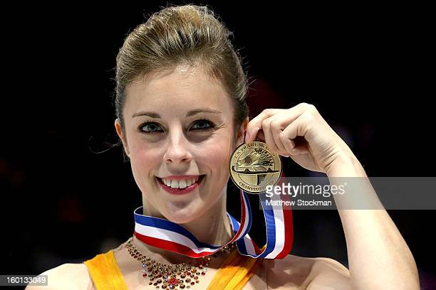 Ashley Wagner poses for photographers after winning the Ladies competition during the 2013 Prudential US Figure Skating Championships at CenturyLink...