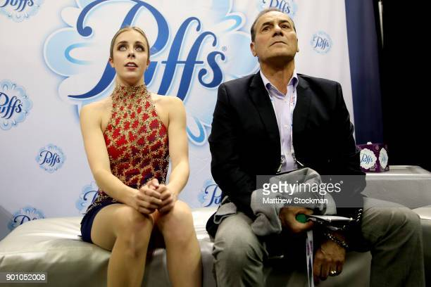 Ashley Wagner waits for her score in the kiss and cry with coach Rafael Arutunian after skating in the Ladies Short Program during the 2018...