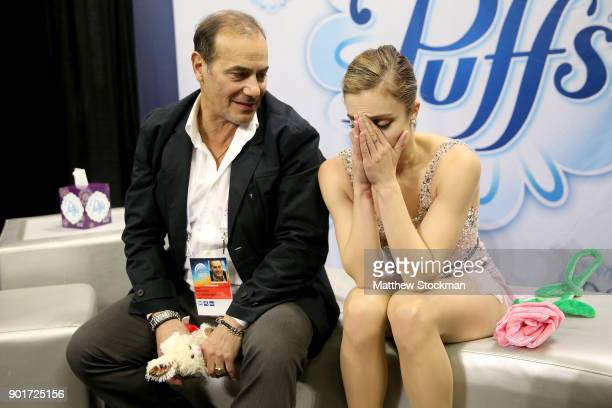 Ashley Wagner waits for her score in the kiss and cry with coach Rafael Arutunian after skating inthe Ladies Free Skate during the 2018 Prudential US...