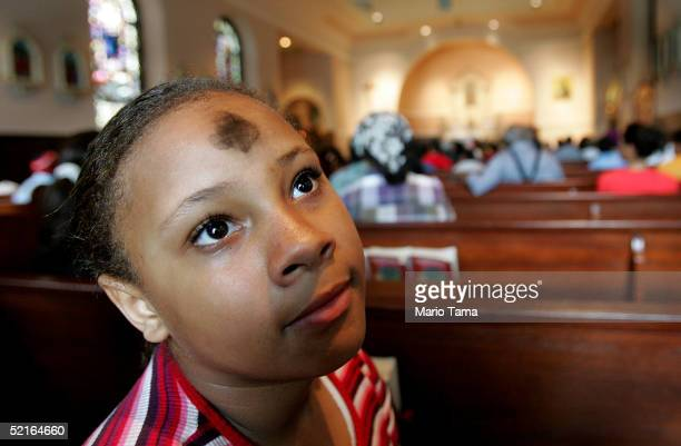 Ashley Wagner wears a cross of ashes on her forehead prior to Ash Wednesday services at St Jude's Church the day after Mardi Gras festivities...