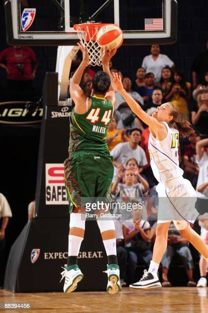 Ashley Walker of the Seattle Storm shoots a jump shot against Laurie Koehn of the Phoenix Mercury during a WNBA game at US Airways Center on May 30...