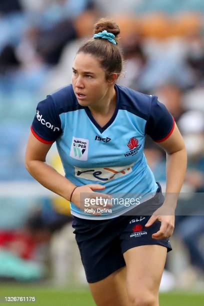 Ashley Walker of the Waratahs runs during the Super W Final match between the NSW Waratahs and the Queensland Reds at Coffs Harbour International...