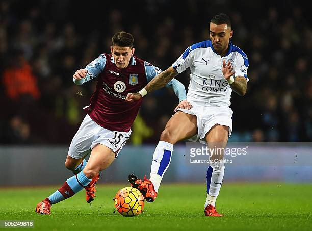 Ashley Westwood of Aston Villa and Danny Simpson of Leicester City compete for the ball during the Barclays Premier League match between Aston Villa...